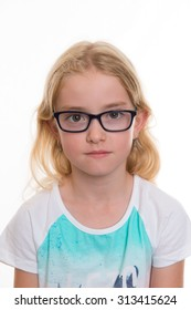 little blond girl with glasses in front of white background