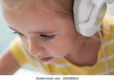 Little blond girl in headphones