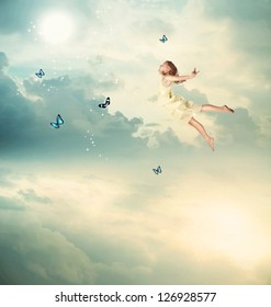Little Blonde Girl Flying with Butterflies at Twilight