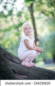 Little blonde girl outdoors