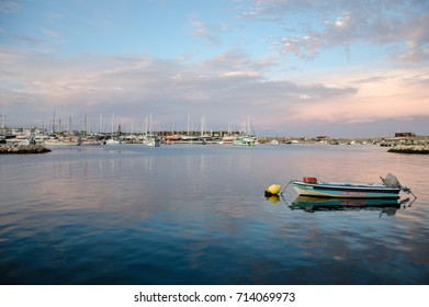 Little boat, sunset, Marina of Lagos, Algarve region, South Portugal