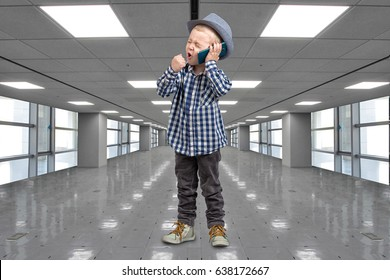 Little boss talks on his mobile phone.Emotional conversation.A great bargain at the Mall.