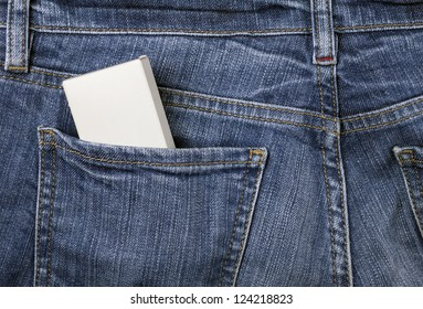 Little box with copy space to add text in the back pocket of blue jeans
