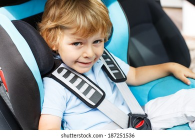 Little boy of 3 years sitting in safety car seat