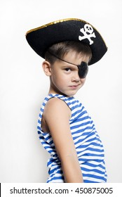 Little  boy 5-6 years old  wearing a pirate costume. White background