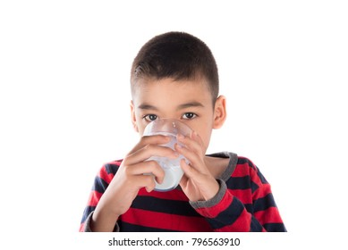 Little boy 8 years old drinking milk with smiling face on white background