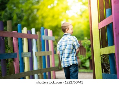 A little boy with ADHD, Autism, Aspergers syndrome enjoys playing with his sister at the park on a beautiful summers day, active, energetic