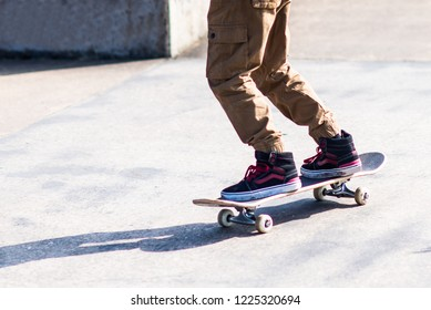 A little boy with ADHD, Autism, Aspergers Syndrome practicing his skateboarding at the local skate park, energetic and enthusiastic,