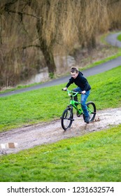 A little boy with ADHD, Autism, Aspergers Syndrome enjoys a day at a BMX track riding and practicing tricks, falling off, crashes but getting up again!