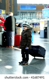 Little boy in airport with luggage