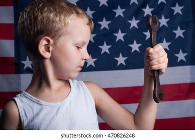 the little boy with the American flag in the background, in honor of labor day, happy patriot's day