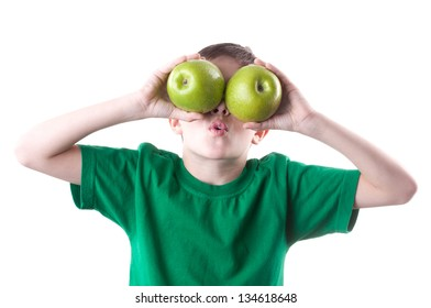 Little boy with apples. Isolated on white background.