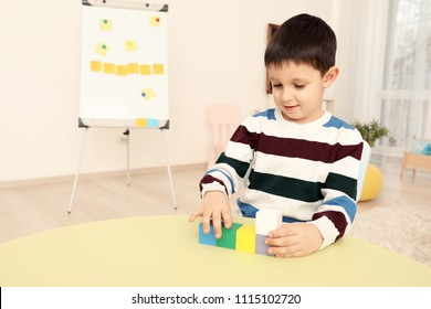 Little boy with autistic disorder at child psychologist's office