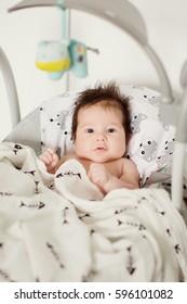 little boy in baby chair