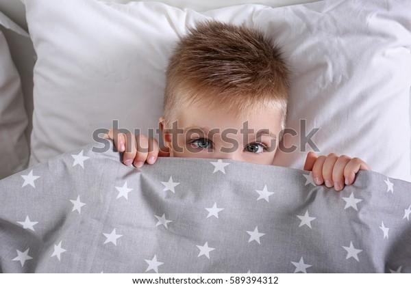Little boy in bed