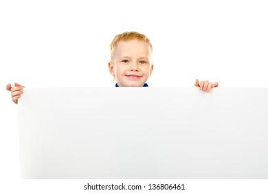 little boy behind a white board