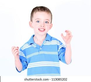 Little boy being silly in studio