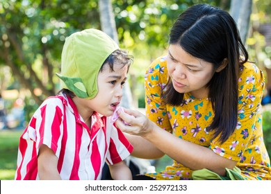 Little boy Bleeding at the mouth and mother help first aid to him