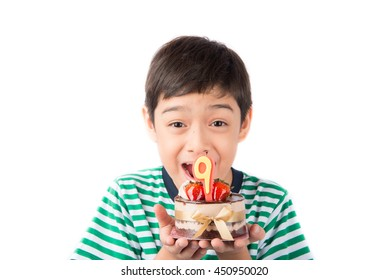 Little boy blowing candle on the cake for his birthday