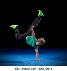 Little boy break dancer on black