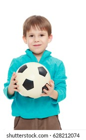Little boy in brown pants and blue shirt playing with a soccer ball.Close-up.Isolated on white background.