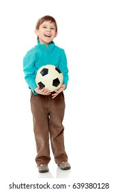 Little boy in brown pants and blue shirt playing with a soccer ball.From fun boy laughs out loud.Isolated on white background.