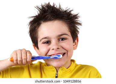 little boy is brushing his teeth