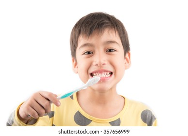 Little boy brushing his teeth on white background