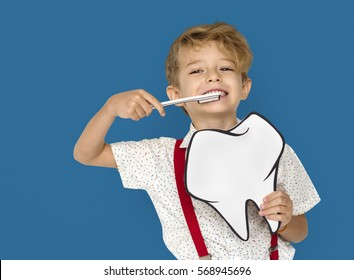 Little Boy Brushing Teeth Holding Paper craft Tooth