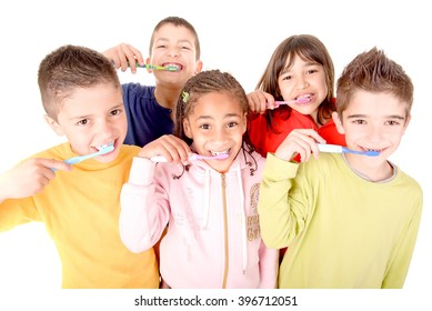 little boy brushing teeth isolated in white