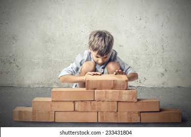 Little boy building a house