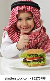 Little boy with burger