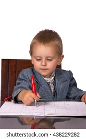 Little boy in a business suit signs documents on white background
