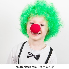 little boy with carnival mask as a clown
