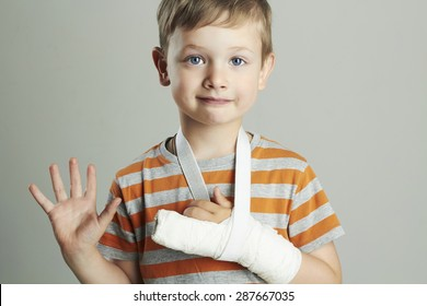 little boy in a cast.child with a broken arm. funny kid after accident.