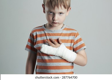 little boy in a cast.child with a broken arm.kid after accident.