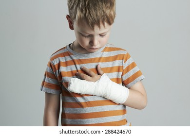 little boy in a cast.child with a broken arm.kid after accident