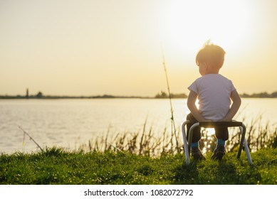 Little boy catching a fish. Happy vacations concept.
