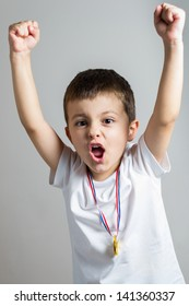 Little boy celebrates his golden medal