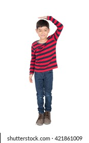 Little boy checking his height on white background