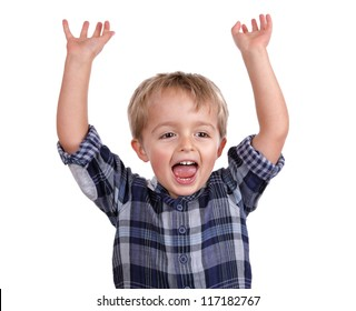 Little boy cheering with his arms raised in the air
