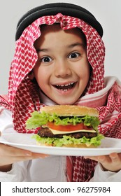 Little boy with cheeseburger