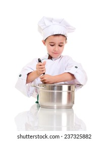 Little boy chef with ladle stirring in the pot isolated on white