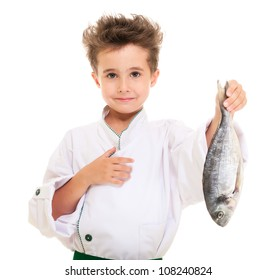 Little boy chef in uniform presenting  dorado fish isolated on white