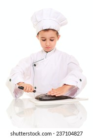 Little boy chief gutting fish isolated on white