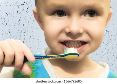 Little boy child brushing his teeth with a toothbrush