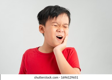 little boy child have toothache, toothache emotions large inflated cheek emotion background