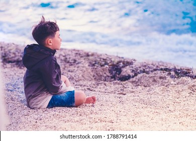 little boy child meditating on the beach mindful breathing