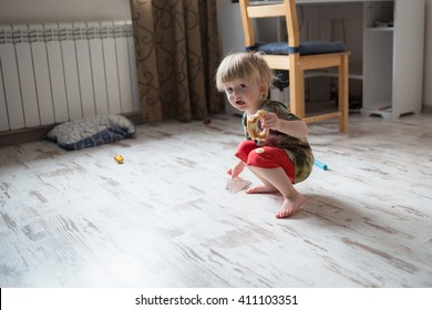 little boy  child toddler plays  at home . casual lifestyle photo series in real life interior casual lifestyle photo series in real life interior