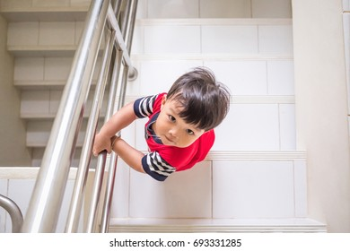 Little boy climb up the stairs from high angle view